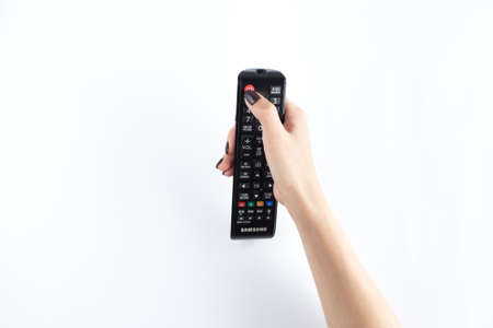 Television controller for smart television in woman hand