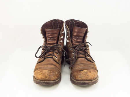 Old leather boots on white background photo