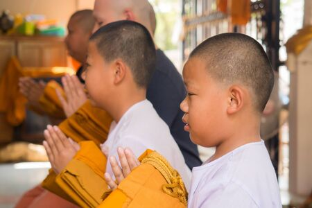 ordain: Yasothon, Thailand - 2212015 : 5 Unidentified Asian young boys become a monk  on 2212015 in Yasothon, Thailand