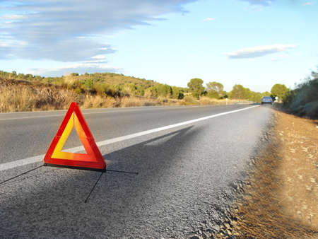 safety triangle in the middle of the road after a car breakdown