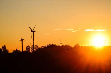 generating station: Windmills at sunset - windmills at sunset sun