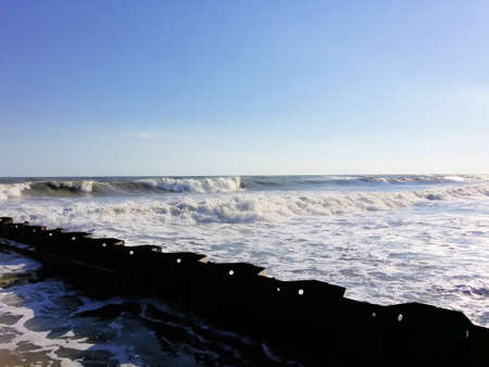 barrier: Waves beating upon a barrier Stock Photo