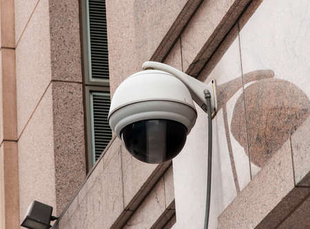 oversight: A street camera on a building Stock Photo