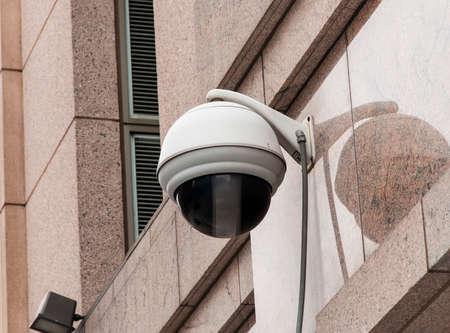 A street camera on a building Imagens