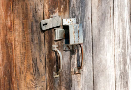 latch: A lock and latch on a fence Stock Photo