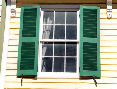 A wood window with shutters
