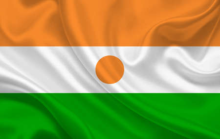 Niger country flag on wavy silk fabric background panorama - illustration