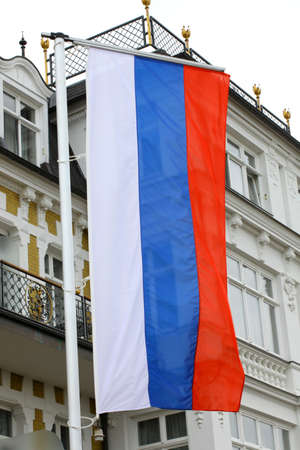 Huge hanging flag of Russia on the street - Photo