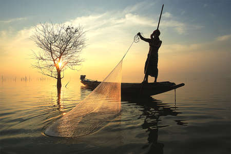 morning blue hour: Fisherman in sunrise