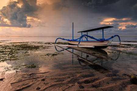 morning blue hour: boat at sanur beach