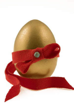 testicle: Golden testicle  decorated with red ribbon