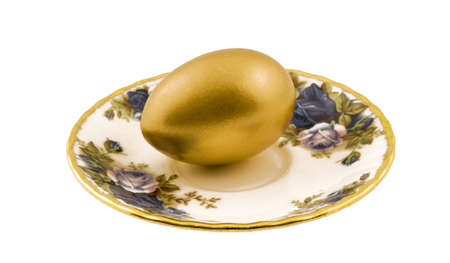 Golden egg on a plate Stock Photo