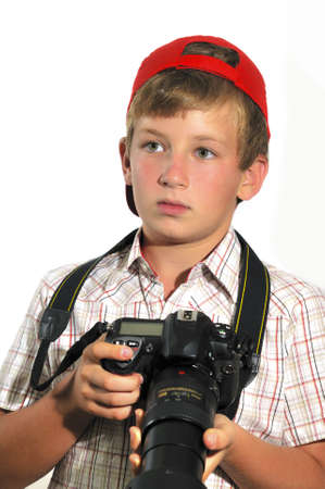 wants: The boy stands with a camera and wants to shoot