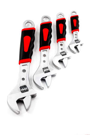 vanadium: Set of adjustable spanners with colour rubber handles on a white background