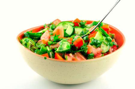 トマトと白の背景にはセラミック ボールでキュウリのサラダ 写真素材