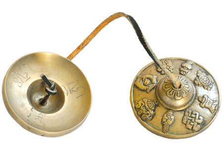 tibet bowls: Tingsha or Karatal performed by the same Tibetan masters who make singing bowls. They are done according to the old formula transmitted over many centuries from master to apprentice.    Karatal used Buddhist monks in their ceremonies. In the West noticed  Stock Photo