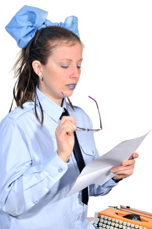 typist: Girl typist carefully read any document in his hands Stock Photo