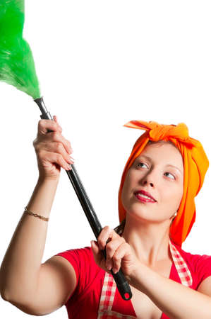 Young girl with a kerchief on her head removes dust in the room photo