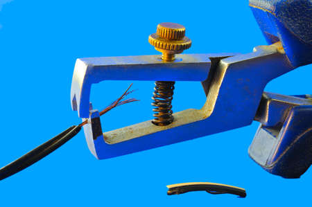 Tool for removing insulation from electrical cables and cable fragment