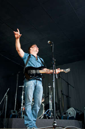 guitarist is on the stage raised his hand welcomed sriteley concert Stock Photo