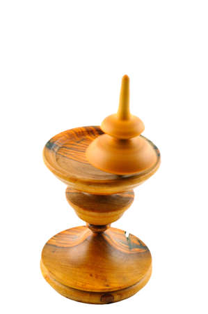 Spinning top made &acirc,&acirc,of wood spinning on a special stand carved out of wood Stock Photo - 17148572