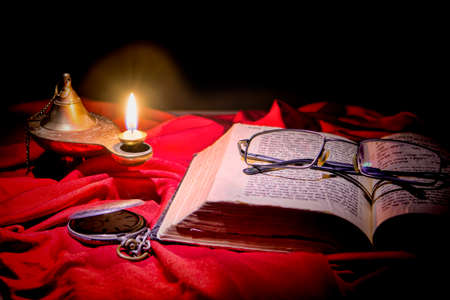 Torah is on the table, covered with a cloth, lit the lamp, man came out not long time left the glasses on the book