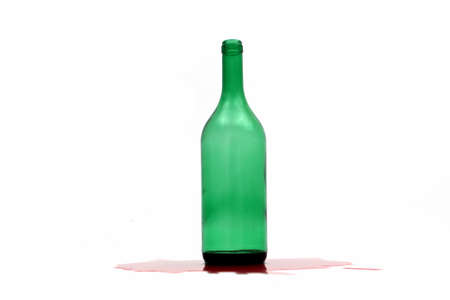 investigated: Bottle with red wine on white