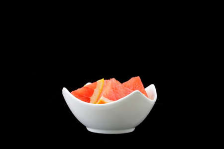 grapefruit: grapefruit pieces in a porcelain bowl Stock Photo