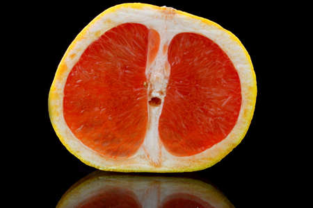 grapefruit: A close-up of half a grapefruit