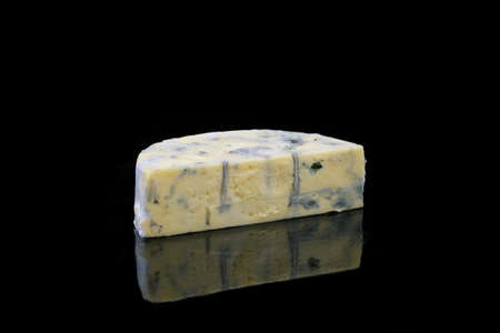 specular: a piece of blue cheese on black background Stock Photo