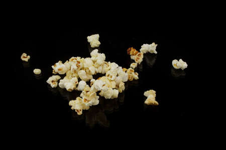 puffed: popcorn heap on black underground