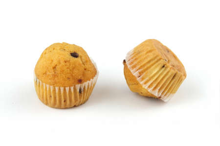 morsels: two muffins with chocolate morsels on white background