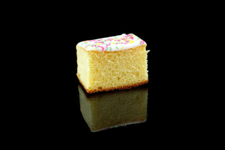piece: a piece of lemon cake on black background