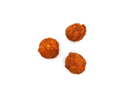 Three meatballs on a white background