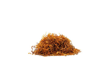 A pile of tobacco on a white background