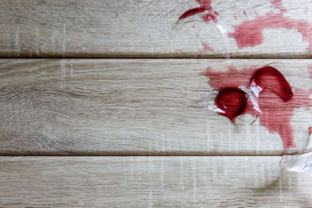 investigated: Broken wine glass on wooden background Stock Photo