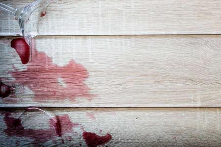 Broken wine glass on wooden background Stock Photo