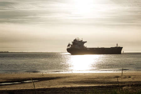 A cargo ship photographed from the beach