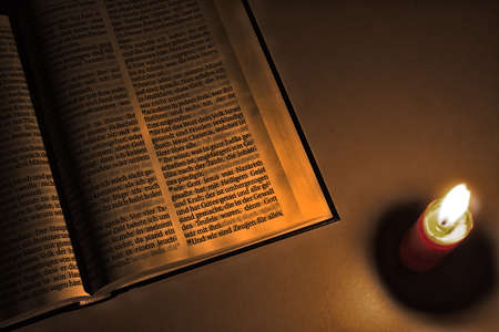 gospels: The bible with candle and candle light Stock Photo