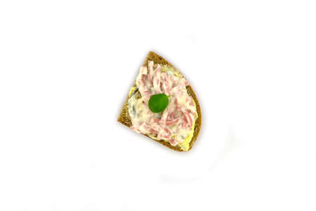 a sandwich with meat salad on a white background