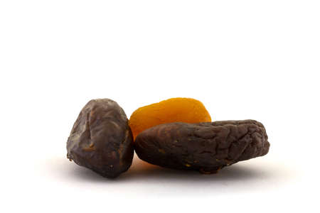 dried figs and apricots on a white background