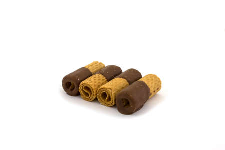 Several chocolate rolls on a white background