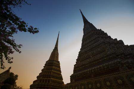 stupas: Silhouettes of stupas at Wat Pho temple, Bangkok, Thailand.