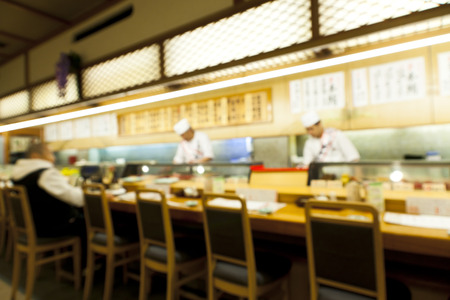 Abstract blurry image of sushi restaurant