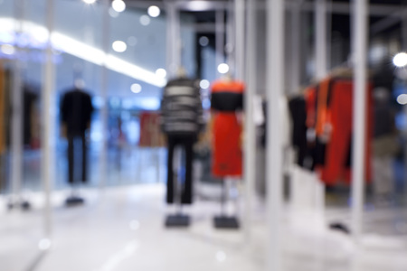Blurred background of fashion shop in shopping mall photo