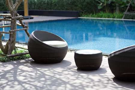 outdoor furniture rattan chairs and table on terrace