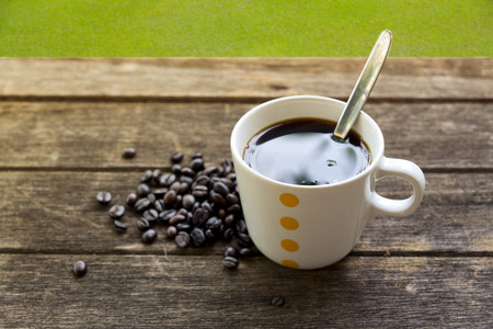 coffee cup and brown coffee beans photo