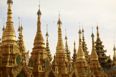 stupas: Golden spires of stupas surrounding the Shwedagon Pagoda Yangon Rangoon, Myanmar