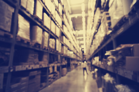 blurred image of boxes in factory warehouse with light leak filter. Reklamní fotografie