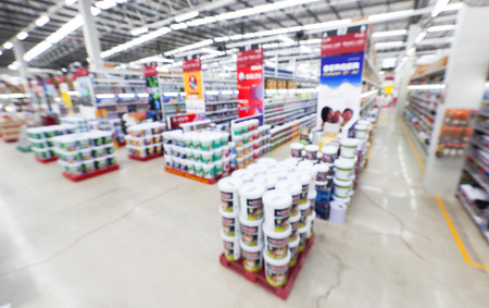 view of home painting department at hardware store ,blur image.